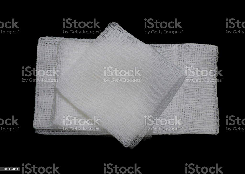 isolated gauze pads on the black background stock photo