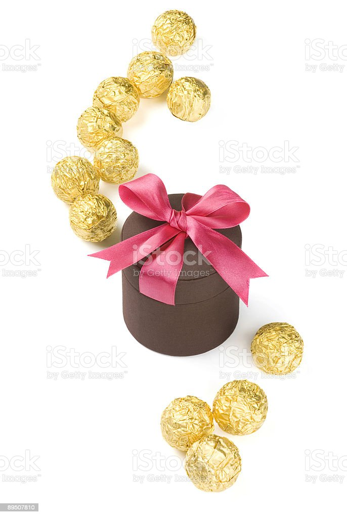 isolated gift box and golden Sphere royalty-free stock photo