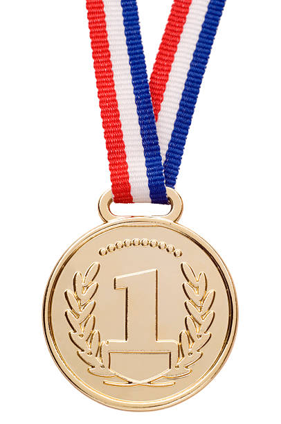 Isolated gold medal with ribbon A gold medal, isolated on white. medal stock pictures, royalty-free photos & images