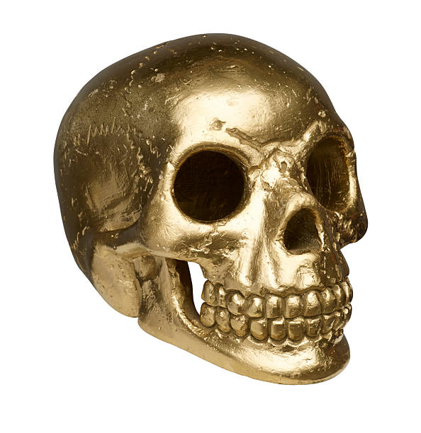 isolated golden skull on white background with clipping path stock photo