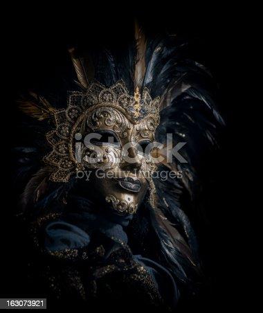 istock isolated golden venetian mask 163073921