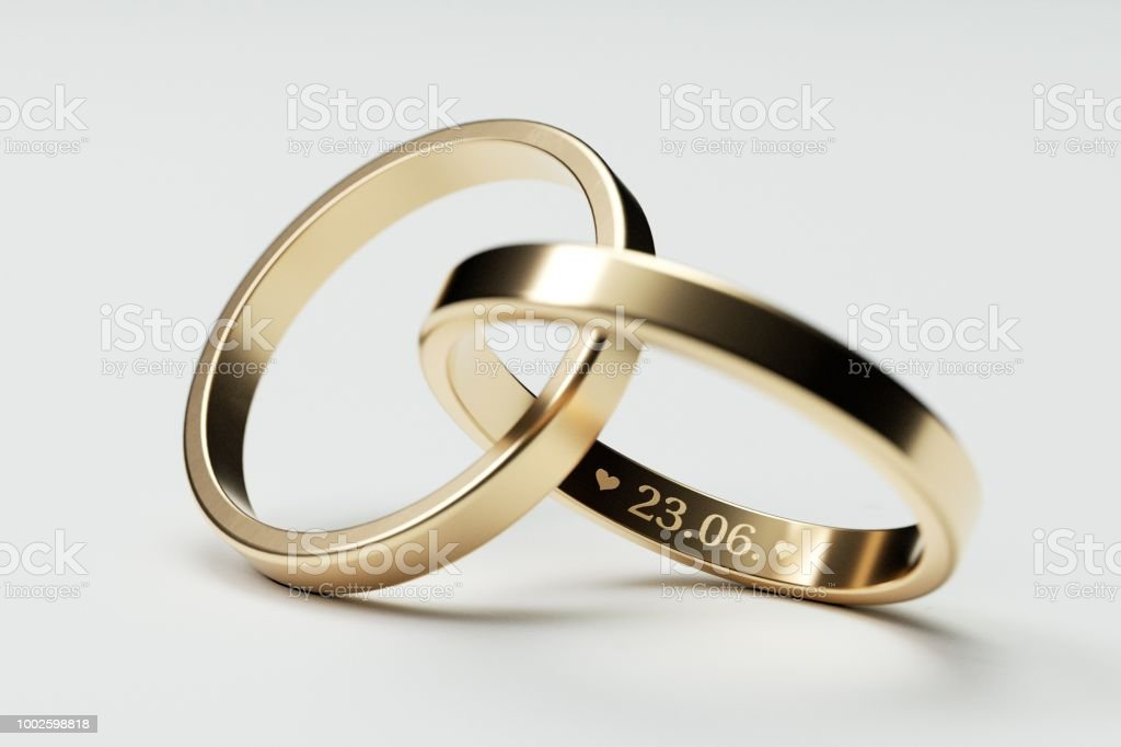 Isolated Golden Wedding Rings With Date 23 June Stock Photo
