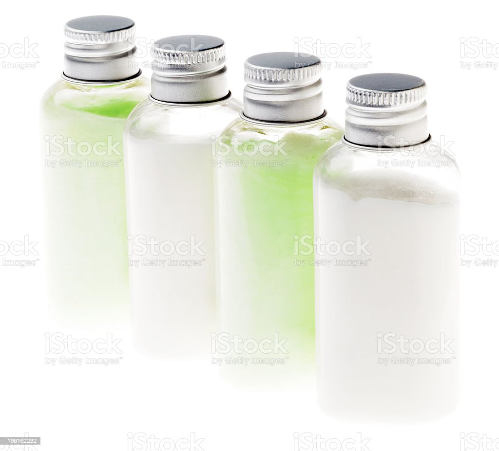 Isolated Green and White Lotion Bottles royalty-free stock photo