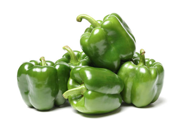 Isolated green capsicum couple on white background stock photo