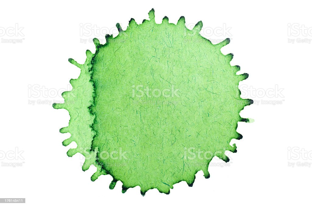 Isolated green ink splatter drop close-up royalty-free stock photo