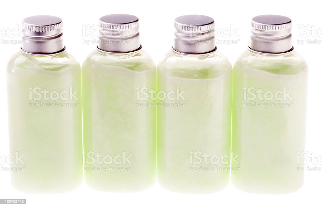 Isolated Green Lotion Bottles royalty-free stock photo