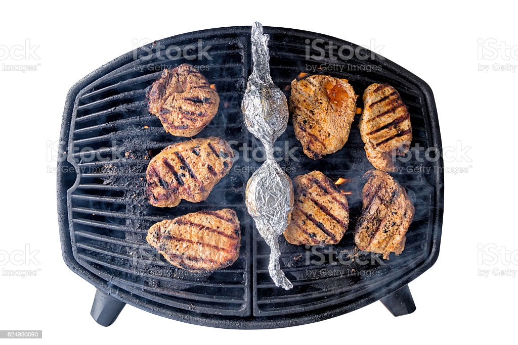 Isolated grill with meat stock photo