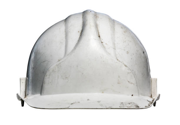 Isolated Grungy Hardhat Isolated Grungy Old White Workmans Hard Hat hardhat stock pictures, royalty-free photos & images