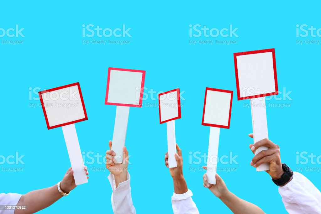 Isolated hand holding blank sign for notice, placard, sales and auction for business stock photo