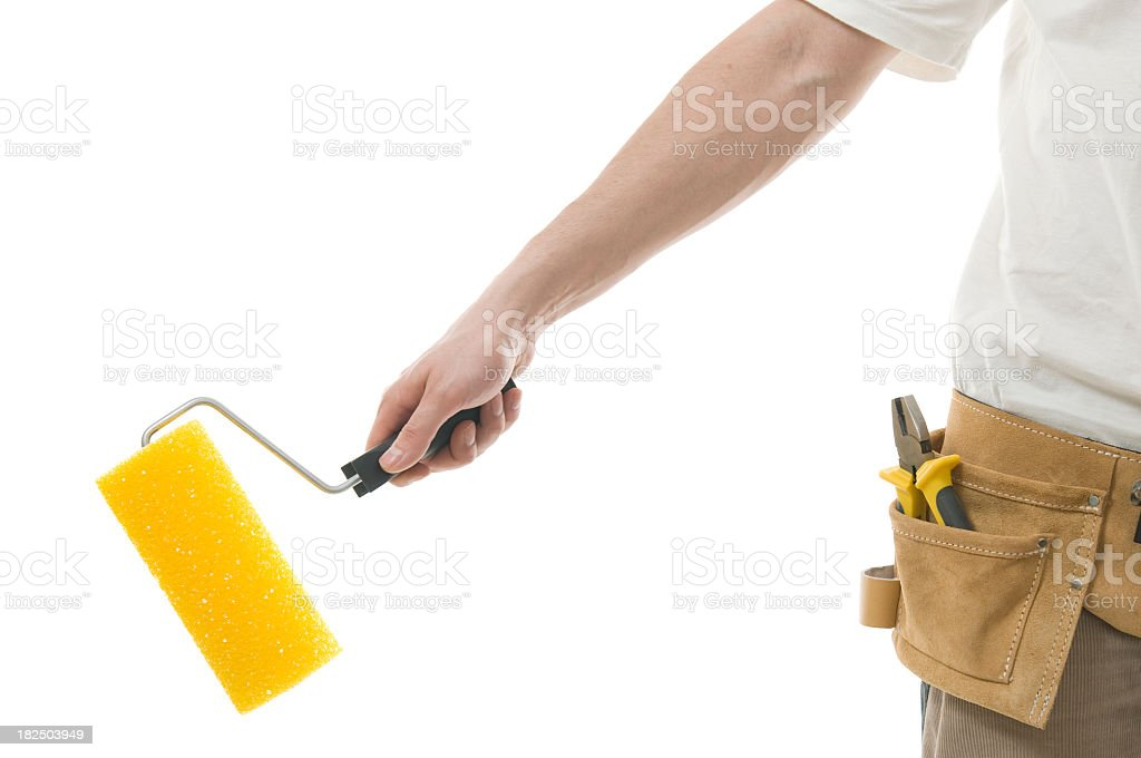 Isolated hand holding paint roller royalty-free stock photo