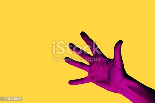 istock Isolated hand photo on yellow background. Pink hand collage style. Bright pop art 1125445853