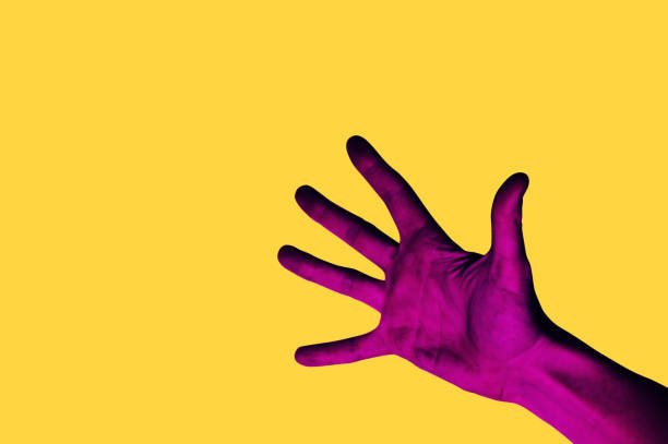 isolated hand photo on yellow background. pink hand collage style. bright pop art - saturated color stock pictures, royalty-free photos & images