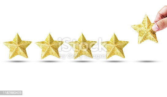 istock Isolated Hand putting luxury golden star for increase star unit from 4 pieces to 5 pieces on white background. Excellent business service rating concept. 1182880423