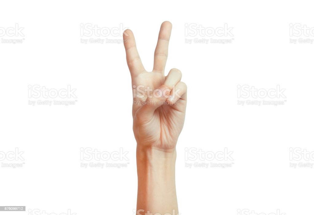Isolated hand signal on white background, male adult hand making a two fingers peace sign stock photo