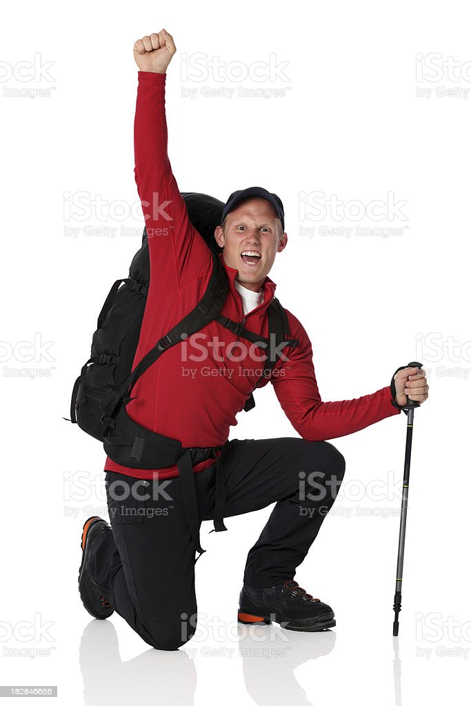 Isolated hiker backpacker celebrating on one knee royalty-free stock photo