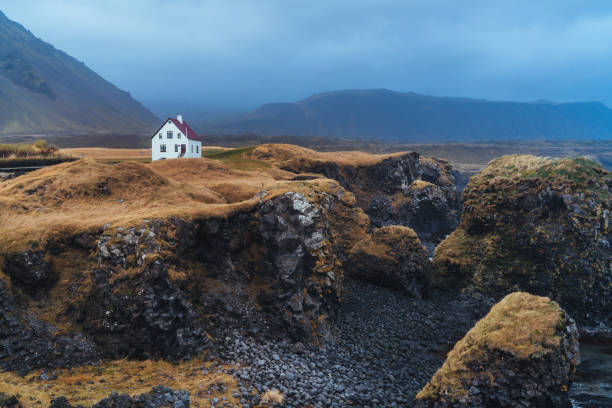 Isolated house in mountains in Iceland stock photo