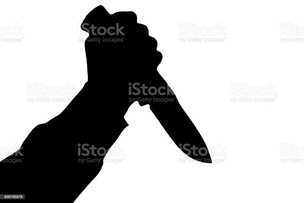 Isolated human hand with killing knife silhouette (shadow) on white background. stock photo