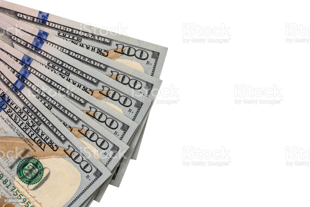 Isolated hundred dollar bills on a white background stock photo