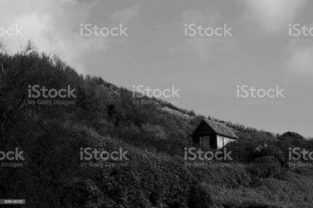Isolated hut on hillside stock photo