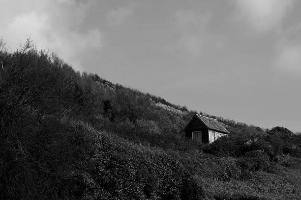 Isolated hut on hillside stock photo