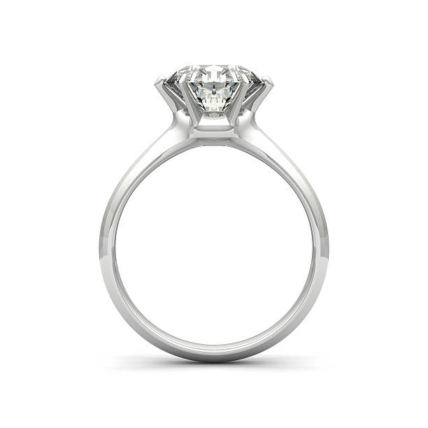 isolated image of a diamond ring on a white background - verloving stockfoto's en -beelden