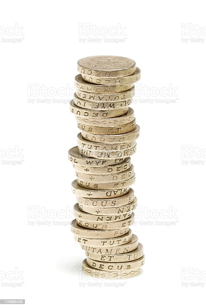Isolated image of a stack of one pound coins royalty-free stock photo