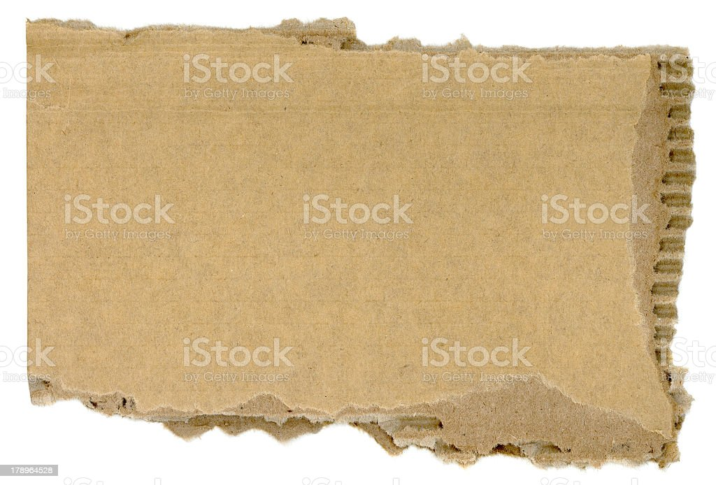 Isolated image of a torn piece of cardboard royalty-free stock photo