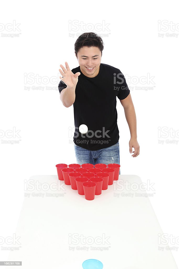 Isolated image of a young man playing beer pong stock photo