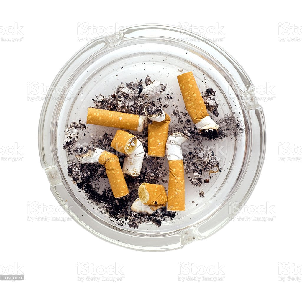 Isolated image of an ashtray with burnt out cigarettes stock photo