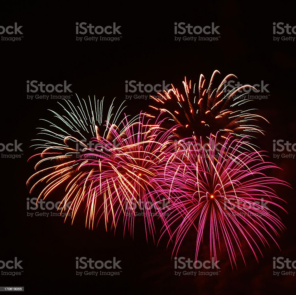 Isolated image of exploding fire crackers on black stock photo