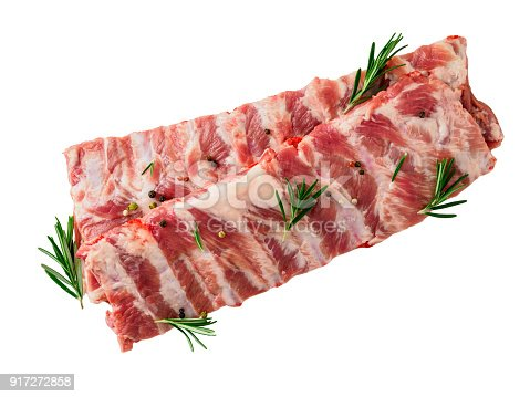 istock Isolated image of raw pork ribs with seasoning  rosemary, pepper on white background, top view 917272858