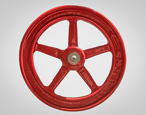 Close Up of a Large Red Industrial Opening Wheel Isolated