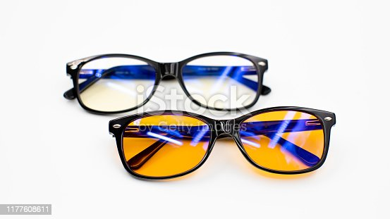 Picture of yellow blue light blocking glasses on white background