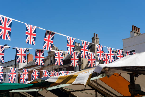 isolated image of union jack royal wedding bunting seen hanging in an outside market during the day of the royal wedding. - matrimonio reale foto e immagini stock