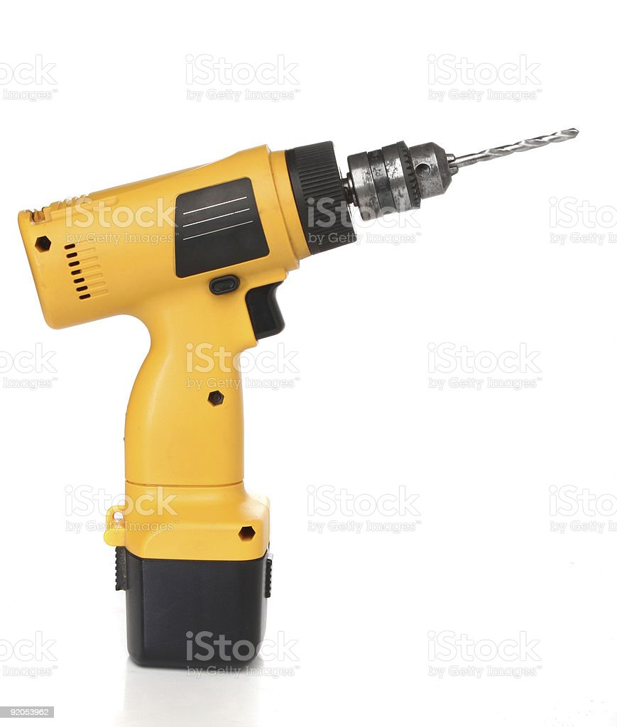 Isolated image of yellow cordless drill machine royalty-free stock photo