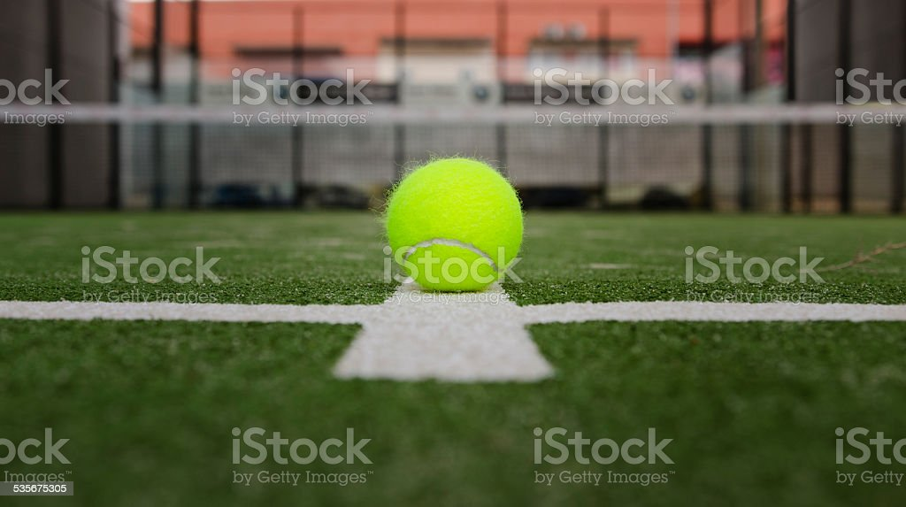 Isolated in court paddle tennis ball stock photo