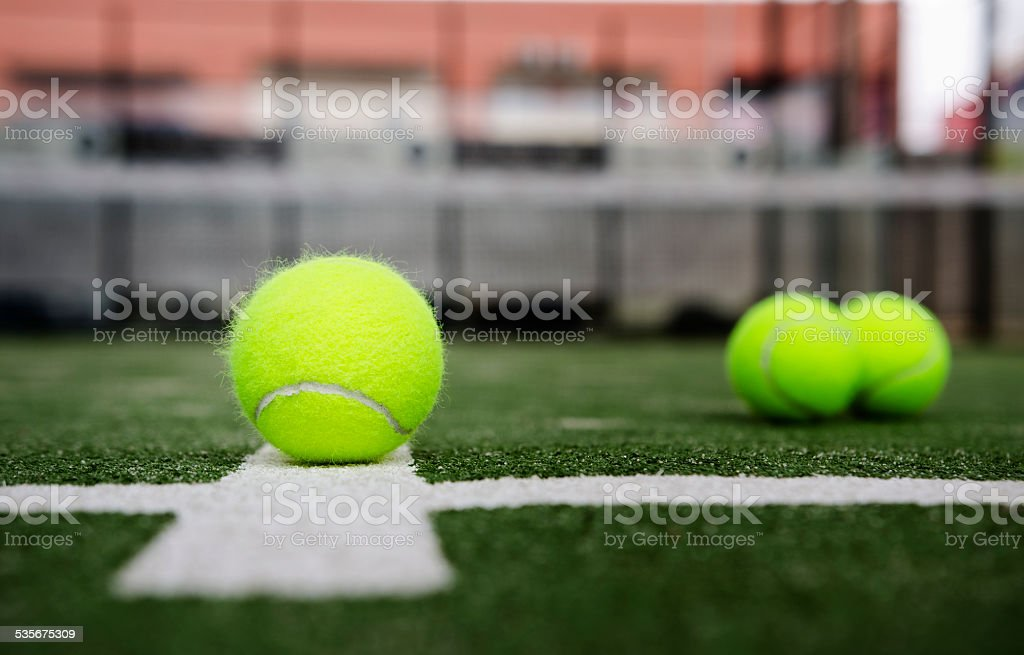 Isolated in court paddle tennis balls stock photo