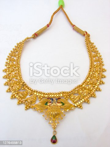 A image showing Indian golden necklace on isolated white background.
