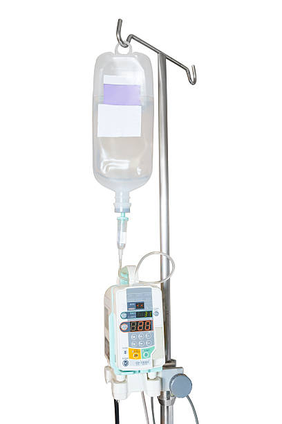 Isolated infusion pump and IV hanging on pole Isolated infusion pump and IV hanging on pole with clipping path saline drip stock pictures, royalty-free photos & images