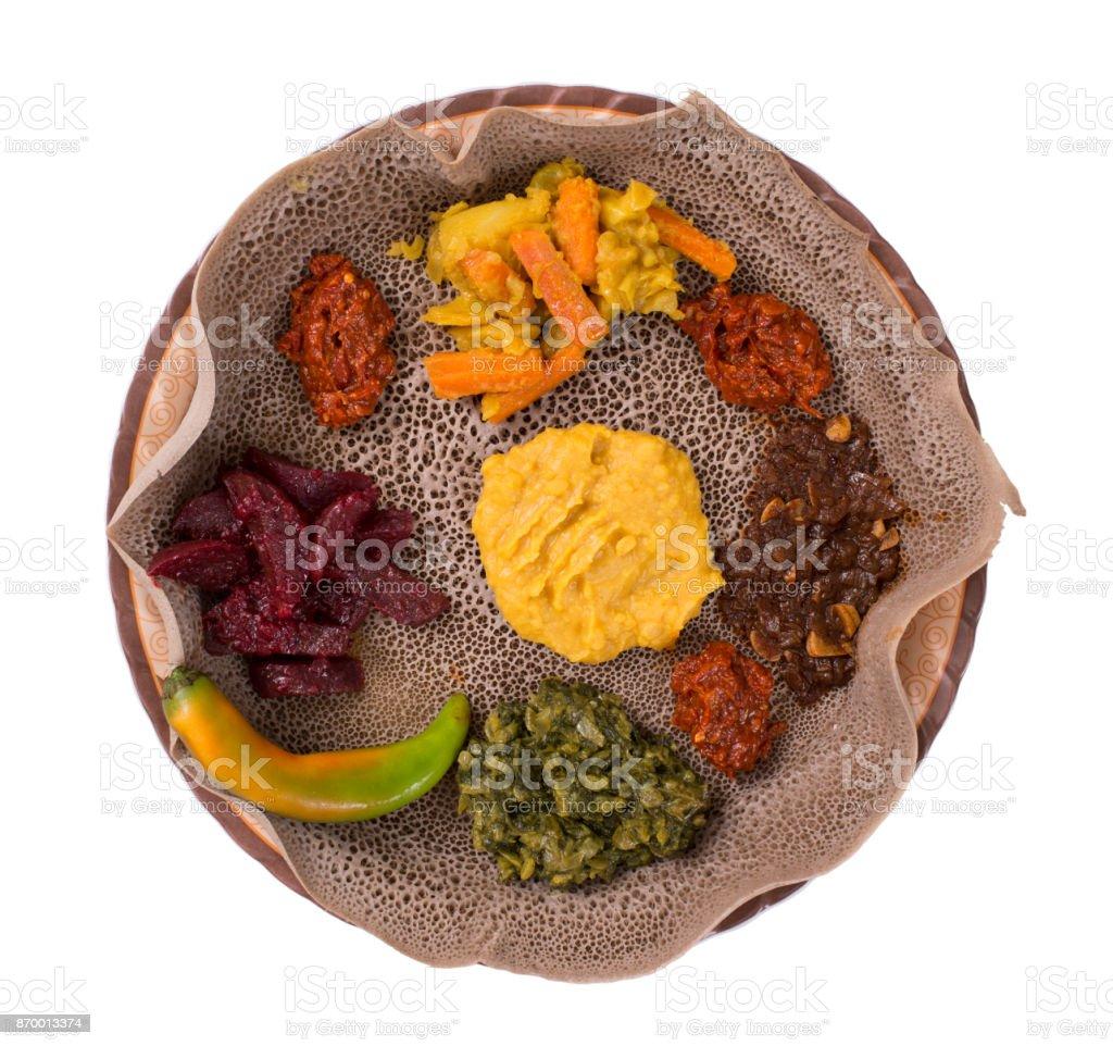 Isolated Injera bread meal. stock photo