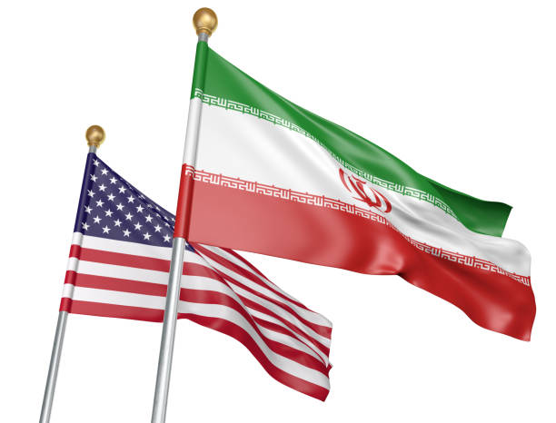 Isolated Iran and United States flags flying together for diplomatic talks and trade relations National flags from Iran and the United States flying side by side to represent relations between the two countries, isolated on a white background. foreign affairs stock pictures, royalty-free photos & images