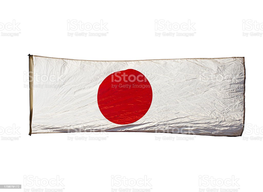 Isolated Japanese flag in wind on white background royalty-free stock photo