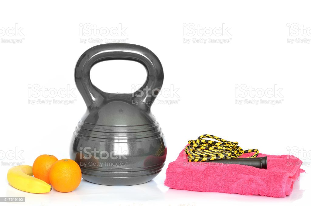 Isolated kettlebell, ab wheel and jumping rope on white background stock photo
