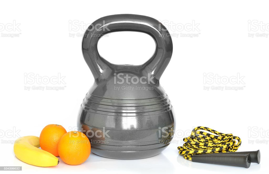 Isolated kettlebell, fresh fruit and jumping rope on white background stock photo