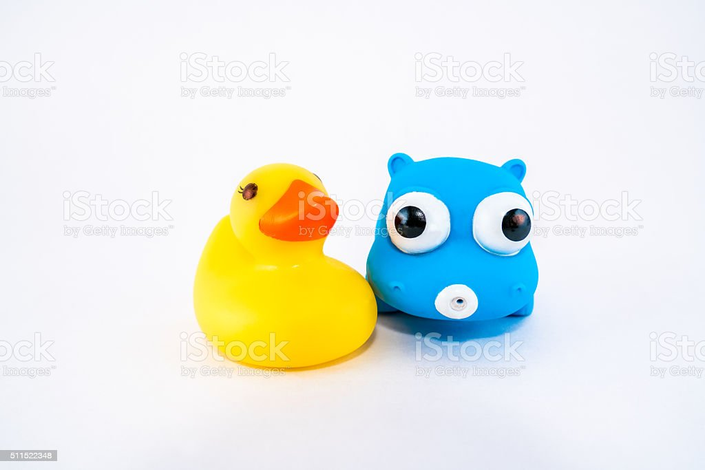 Isolated kids bath toys. Duck and hippo. stock photo