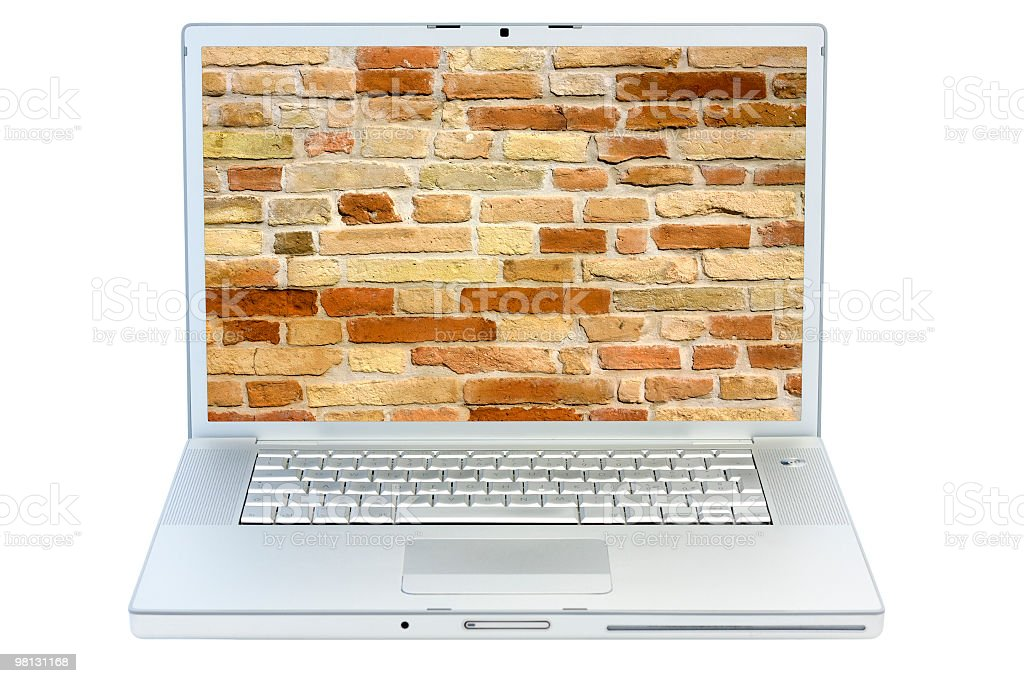 Isolated laptop with brick wall on screen royalty-free stock photo