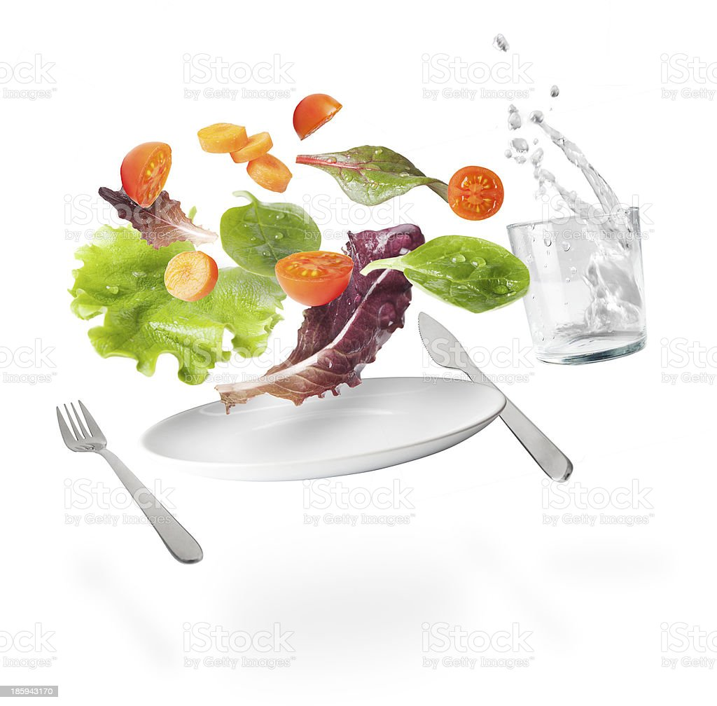 Isolated light salad with floating vegetables stock photo