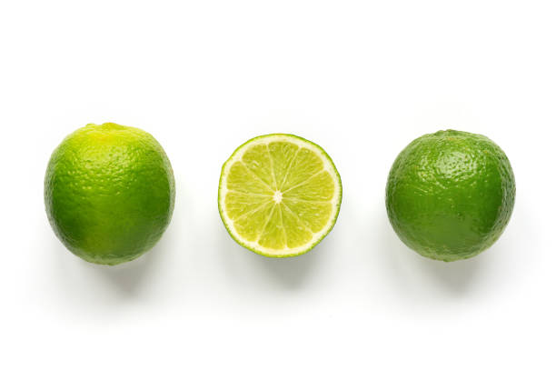 Isolated limes. Row ripe citrus on white background. lime stock pictures, royalty-free photos & images