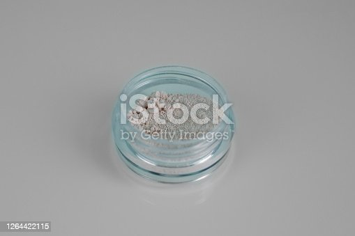 istock Isolated makeup beauty cosmetics product & facial cosmetic, mineral powder. Macro photo. 1264422115