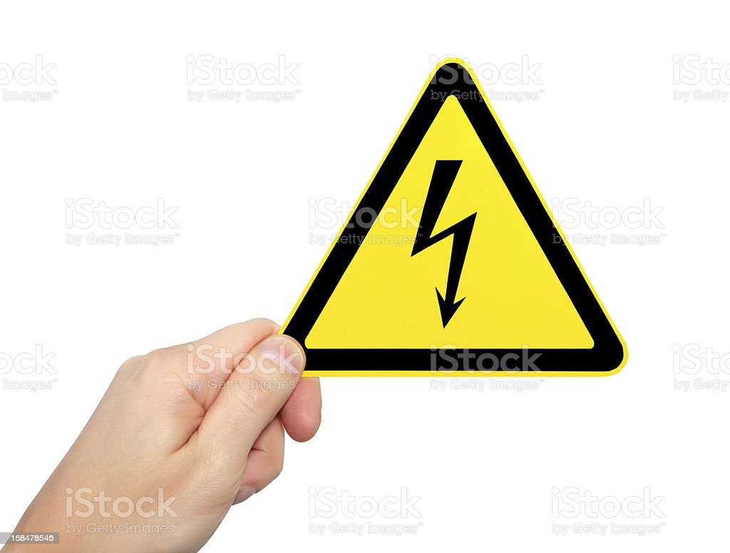 isolated male hand holding sign of danger high voltage symbol royalty-free stock photo